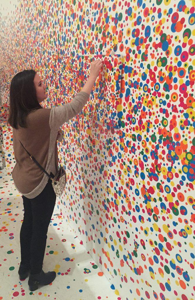 adding a polka dot to a polka dot colored wall