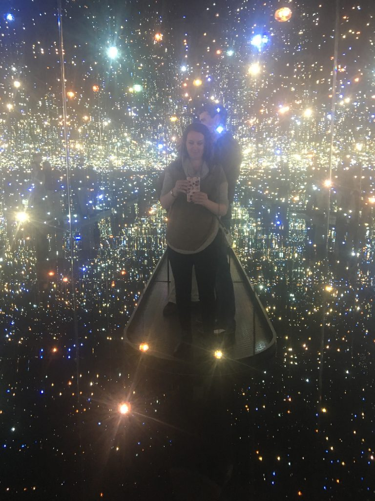 Me standing on the platform of The Souls of Millions Lightyears Away surrounded by orbs of light