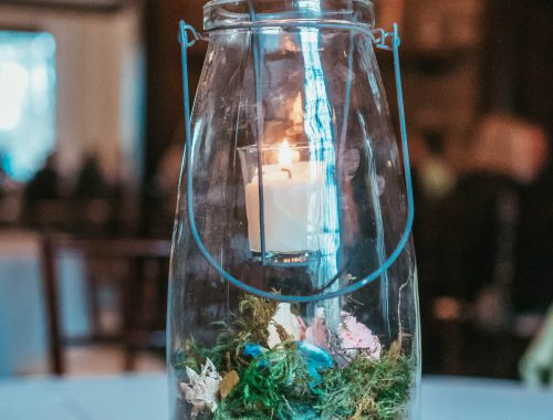 diy woodland wedding lantern with moss and beeswax candle from bee to you candles