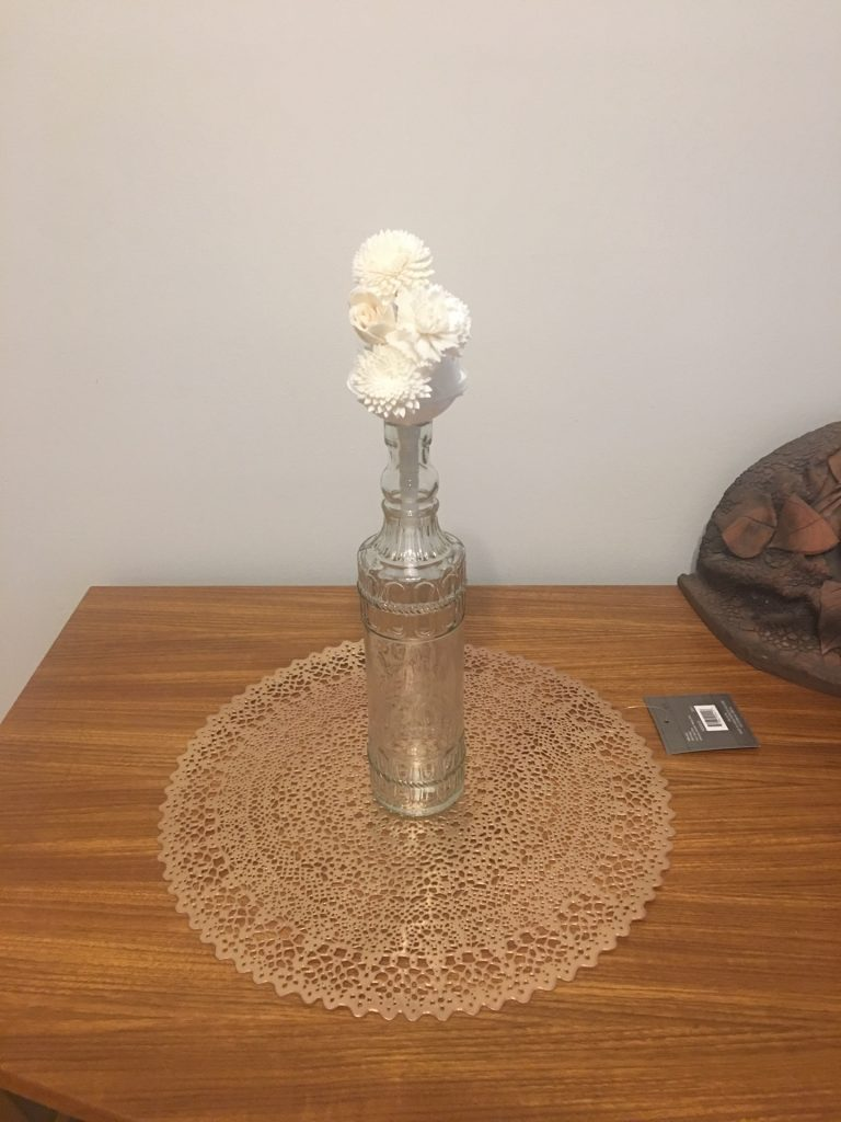 bottle with dried flowers coming out of it
