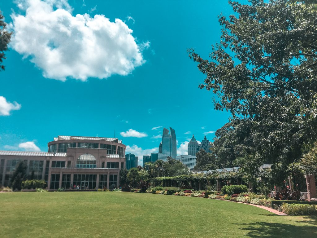 great lawn with the atlanta botanical garden in the back