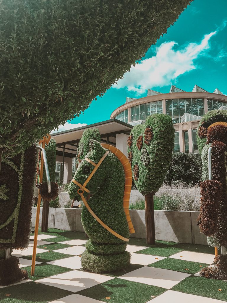 alice in wonderland chess set topiary plant sculptures atlanta botanical garden
