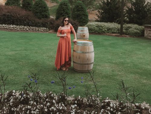 Standing next to a wine barrel at Yonah Mountain Vineyards