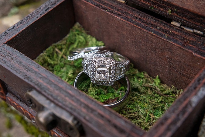 wedding rings in a ring box with moss insert
