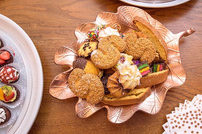 rose gold leaf platter filled with Italian cookies