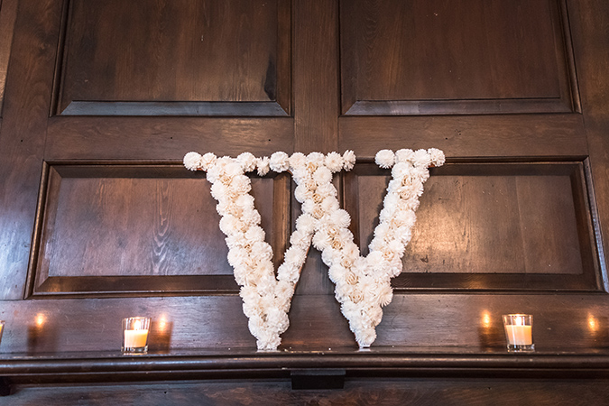 sola flower covered W initial on mantelpiece