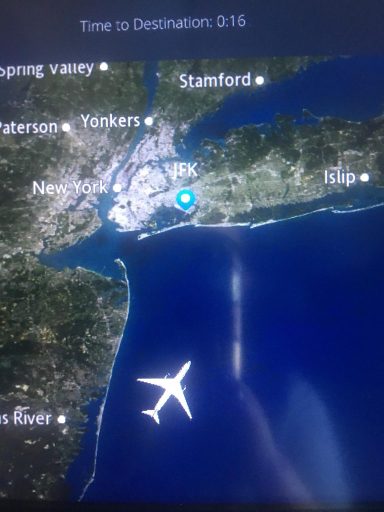 airplane screen showing us nearing JFK airport