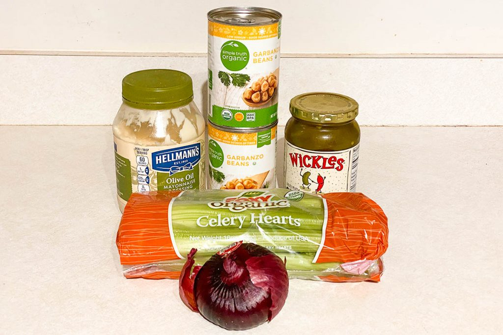 Chickpea salad ingredients are mayo, chickpeas, pickles, celery, and onion