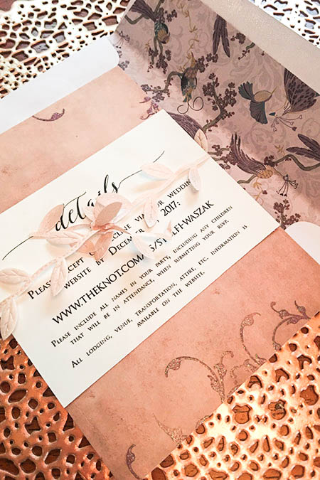 details card tied with ribbon to invitation